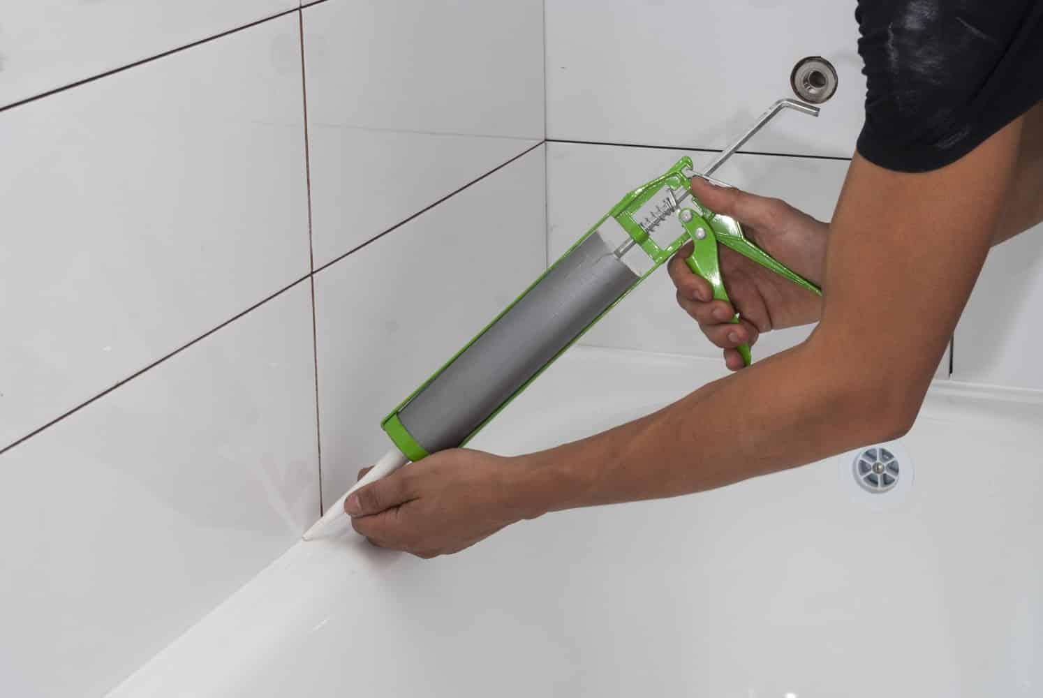 applying waterproofing on bath